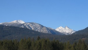 Heron is just to the south of the proposed Scotchman Peaks Wilderness (www.scotchmanpeaks.org) The jagged peak on the right is Sawtooth Mountain. The bulky mountain on the left is Clayton Peak.